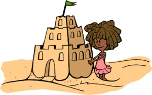 child making sandcastle at a beach
