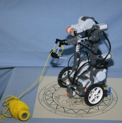 LEGO robot with grappling hook attached to string